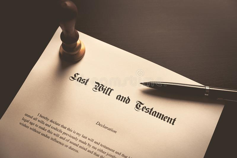 Last Will and Testament concept. Close up of fountain pen on desk royalty free stock photography