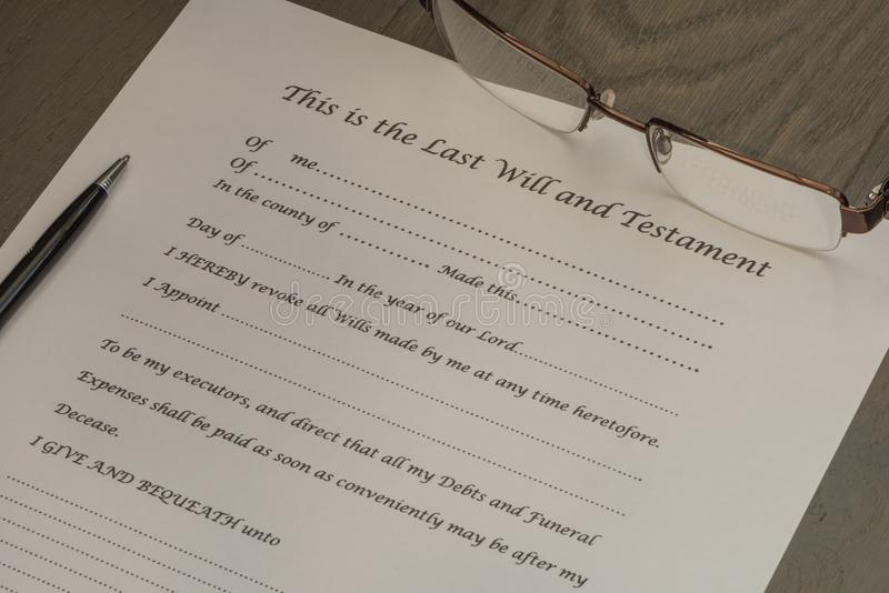 Last Will and Testament document with a pair of glasses and pen. royalty free stock photos