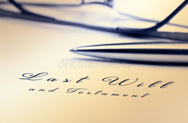 Last will. And testament with pen and reading glasses stock photo