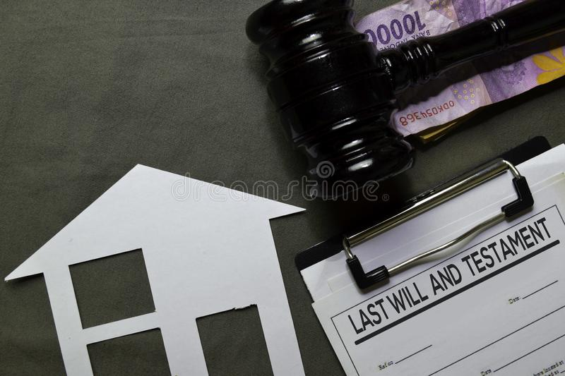 Last Will and Testament text on Document and gavel isolated on office desk. Law concept stock photography