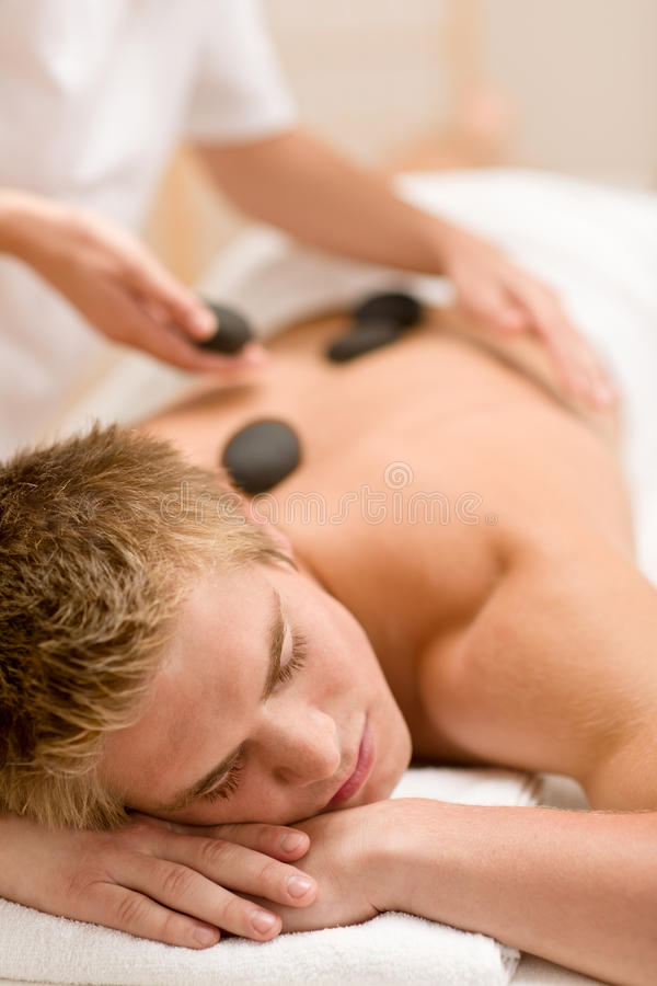 Lastone therapy - man at luxury massage stock images