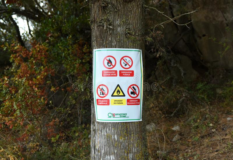 Signs `No Fire`, `No Smoking`, `No Camping` in forest on island Lastovo, Croatia. stock photo
