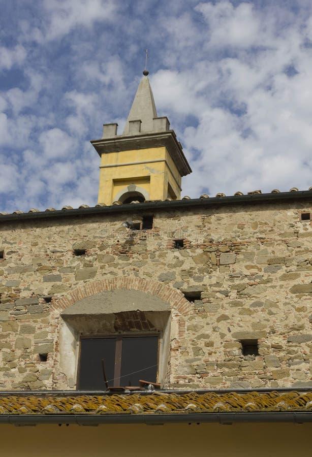 Lastra a Signa belltower. LASTRA A SIGNA, ITALY - JULY 17 2017: Lastra a Signa belltower with rustic stone and brick wall royalty free stock image