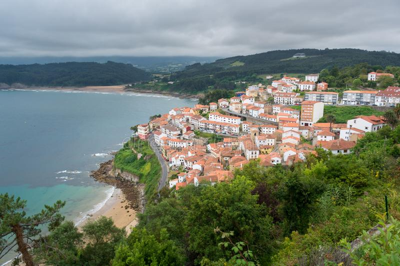 View of lastres a fishermen village in Asturias, Spain. white village houses with red roofs stock image