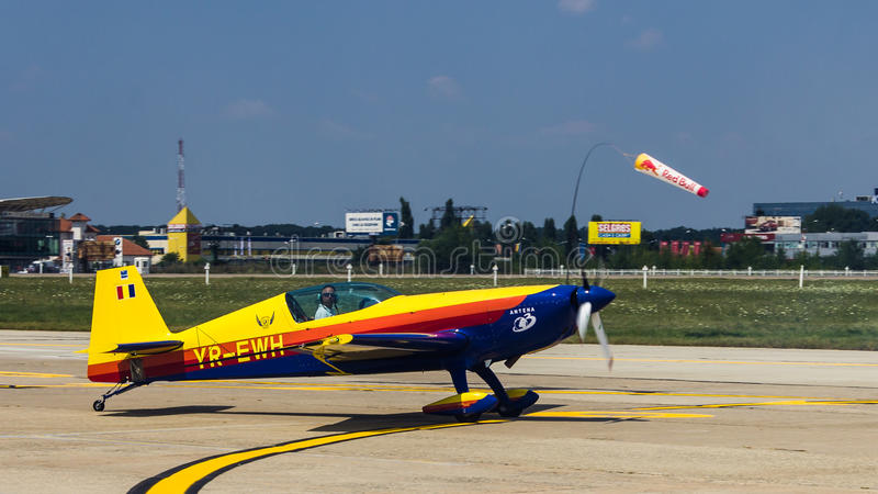 Laszlo Ferencz (Right Wing) with YR-EWH. Laszlo Ferencz (Hawks of Romania) with YR-EWH after aerobatics at Bucharest International Air Show 2013 royalty free stock images