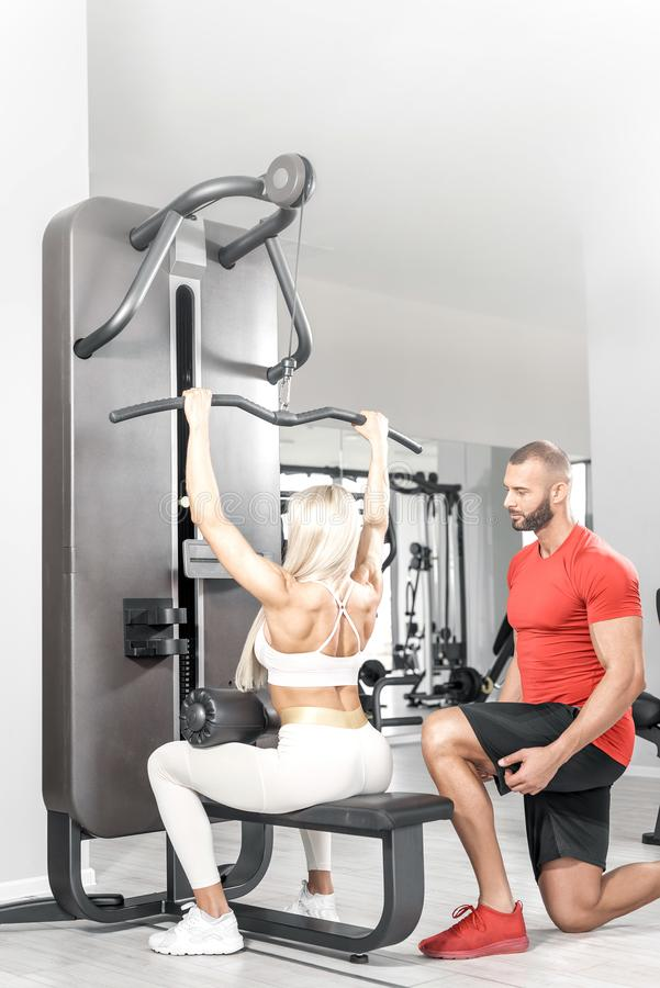 Lat machine back personal training stock images
