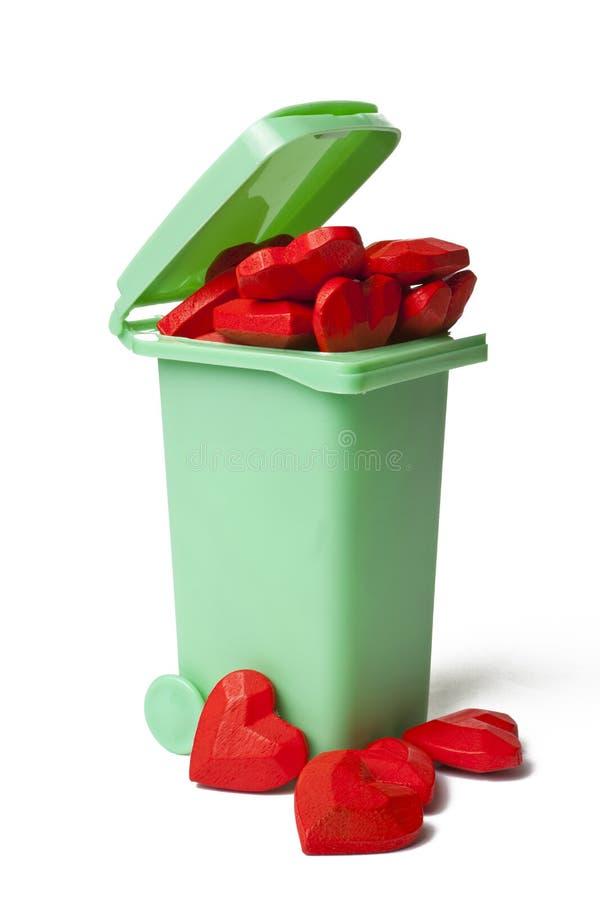 Lata de lixo completamente de Hood Heart vermelho imagem de stock royalty free