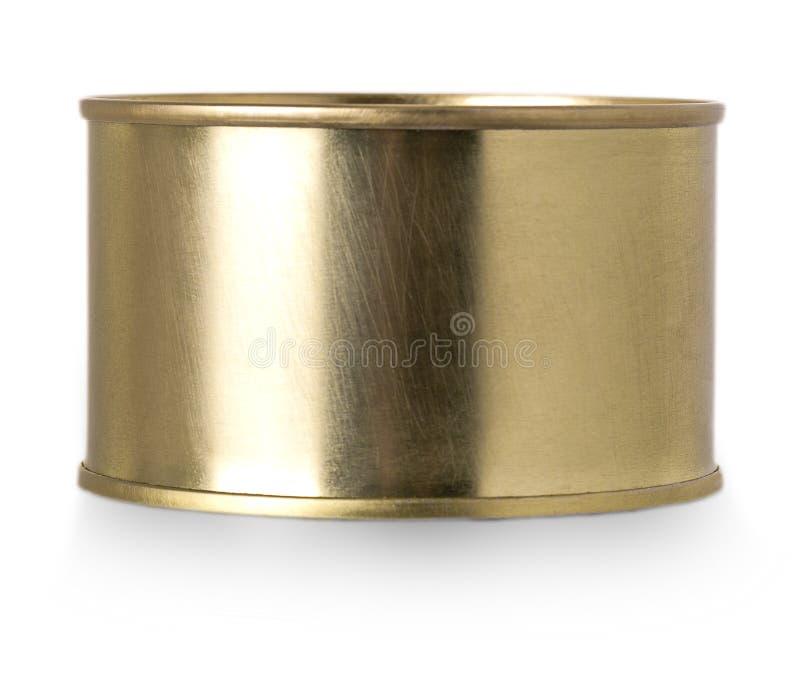 Lata del metal del oro aislada en el fondo blanco imagenes de archivo