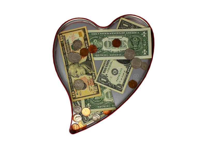 Lata en forma de corazón con donaciones del dinero dentro foto de archivo