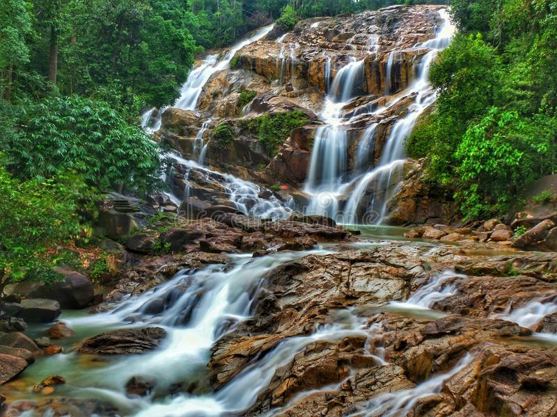 Lata Kinjang Waterfall in Tapah, Perak, Malaysia. Lata Kinjang is located about 18 km from Tapah. The main attraction at this waterfall is the impressive series stock photography