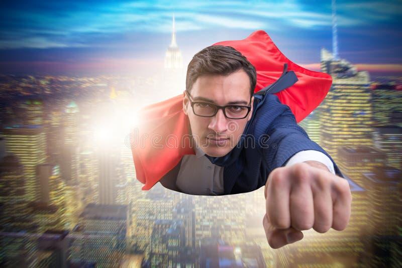 Latający super bohater nad miastem obraz stock