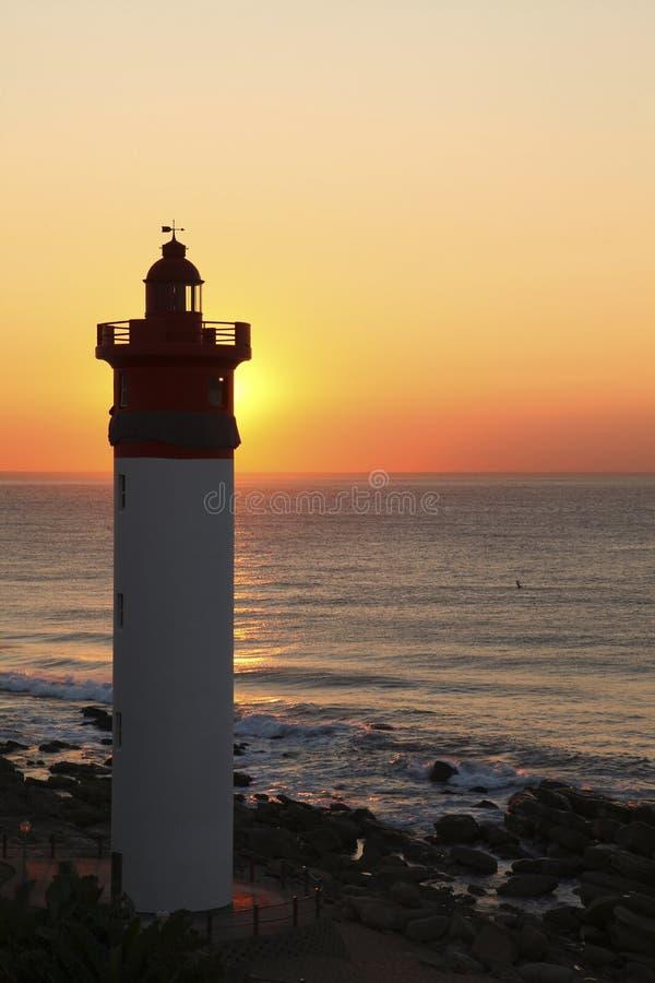 Latarnia morska przy wschód słońca zdjęcie royalty free