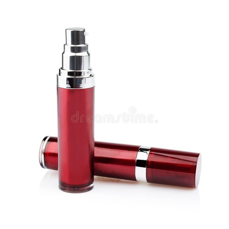Latas cosméticas vermelhas fotos de stock