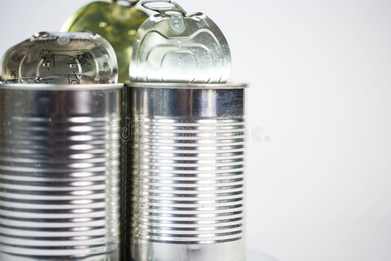 Latas de lata no fundo branco foto de stock royalty free