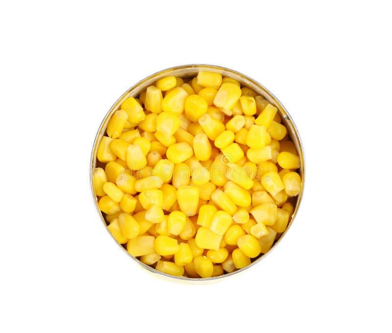 Latas de maíz. Hierro que empaqueta, una foto con el top foto de archivo