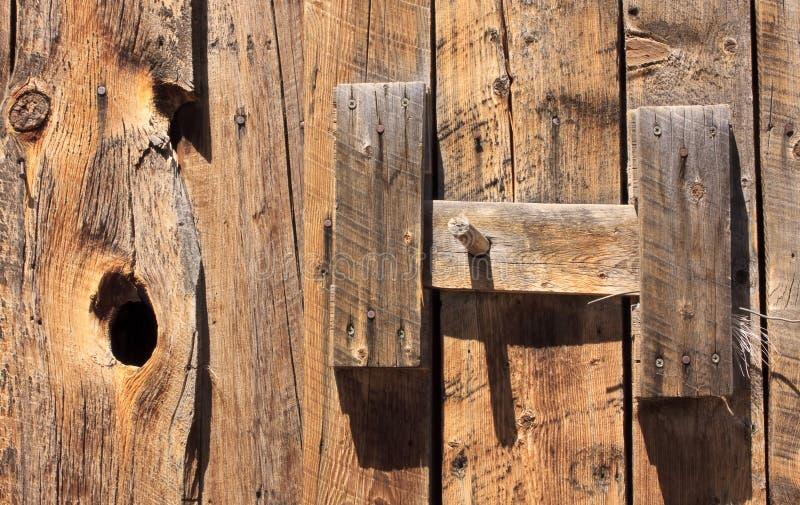 Latch on old barn door stock photos