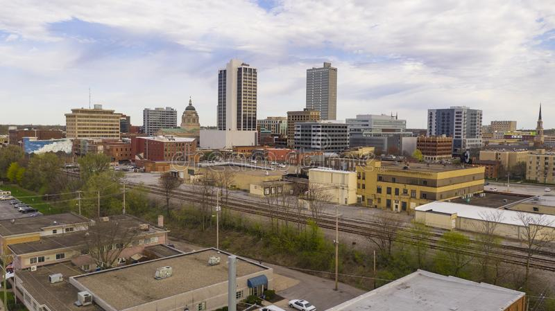 Late Afternoon Light Filtered By Clouds in the Downtown City Center of Fort Wayne Indiana. Train tracks flank the buildings of the urban core in Fort Wayne royalty free stock photography