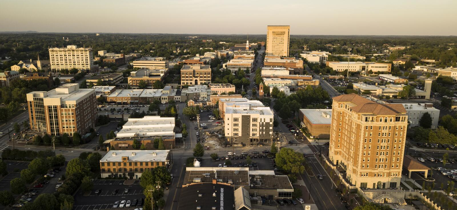 Aerial View Over the Downtown City Skyline and Buildings of Spartanburg. Late afternoon light hits the buildings of downtown Spartanburg North Carolina royalty free stock images