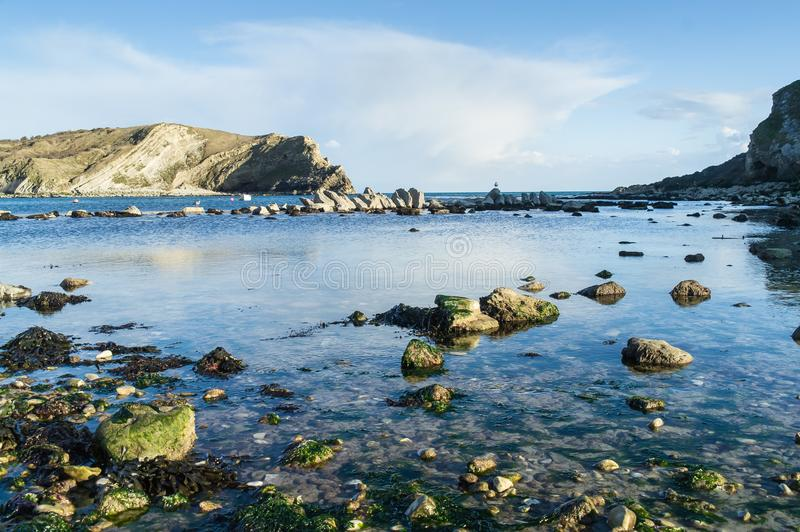 Late afternoon at Lulworth Cove, Dorset royalty free stock image