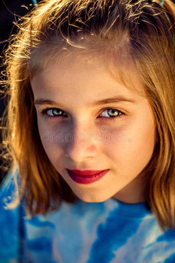Late Afternoon Natural Light Closeup Portrait of Preteen Girl royalty free stock photo