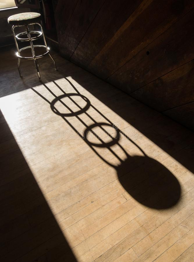 Long shadow, bar stool stock image