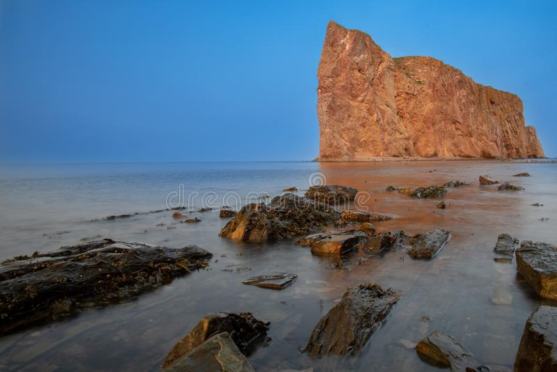 Beautiful Perce Rock, Gaspe Peninsula, Quebec, Canada. Late afternoon shot of the beautiful Perce Rock, Gaspe Peninsula, Quebec, Canada royalty free stock photography