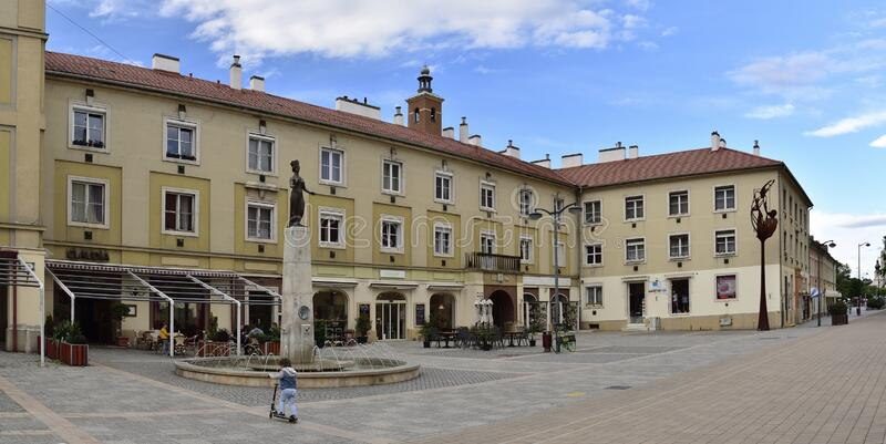 Late afternoon with spring clouds above old city square in Szombathely, Hungary stock photo