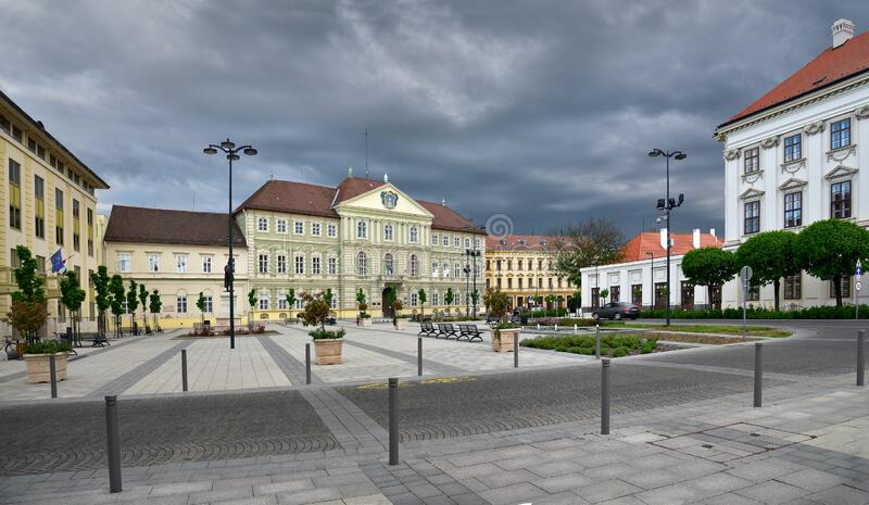 Late afternoon with stormy clouds above the Labor Center of the Vas County Government Office in Szombathely, Hungary. SZOMBATHELY / HUNGARY, APRIL 27, 2019. Late royalty free stock photo
