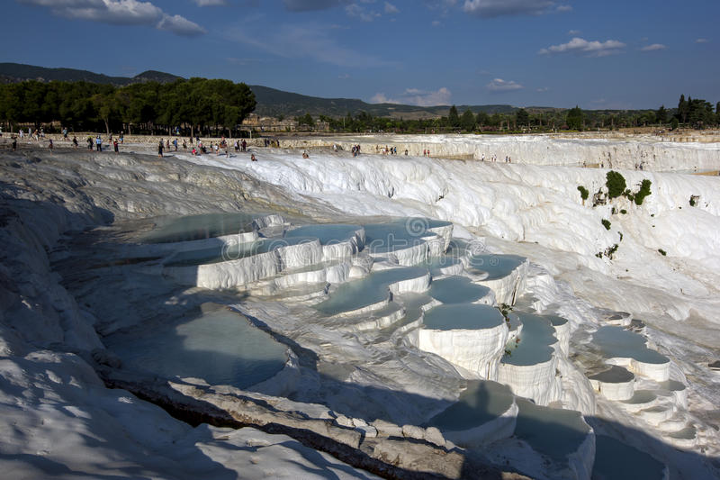 The late afternoon sun shines over the most spectacular section of natural thermal pools at Cotton Castle at Pamukkale in Turkey. The pools, also known as stock image