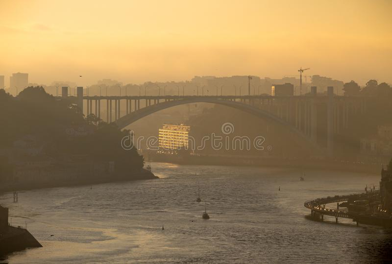 Late afternoon view of Douro River in Porto. A late afternoon view of the Douro River in Porto, with the Arrabida Bridge in the background stock photo