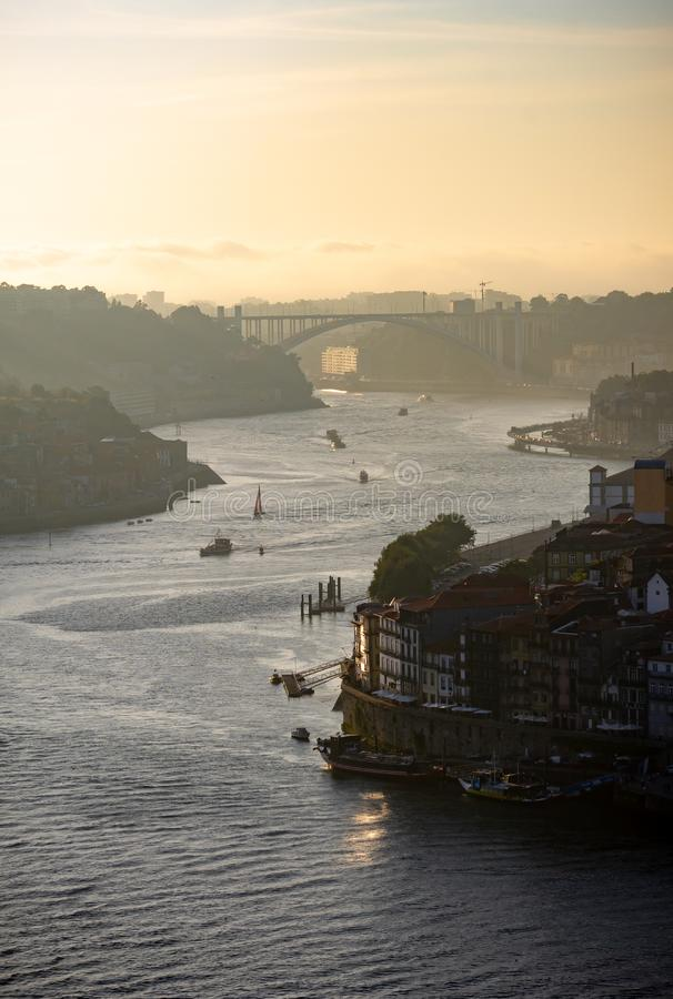 Late afternoon view of Douro River in Porto. A late afternoon view of the Douro River in Porto, with the Arrabida Bridge in the background stock photos