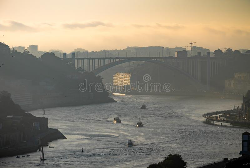 Late afternoon view of Douro River in Porto. A late afternoon view of the Douro River in Porto, with the Arrabida Bridge in the background royalty free stock photography