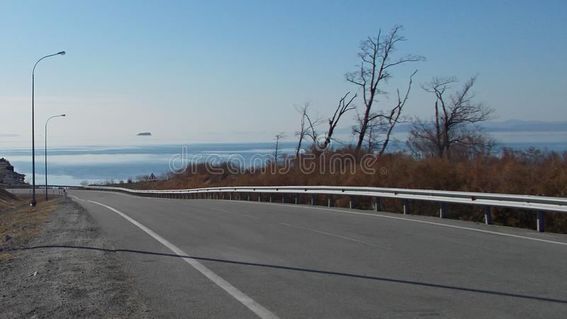 Late autumn. Highway along the seashore. royalty free stock images