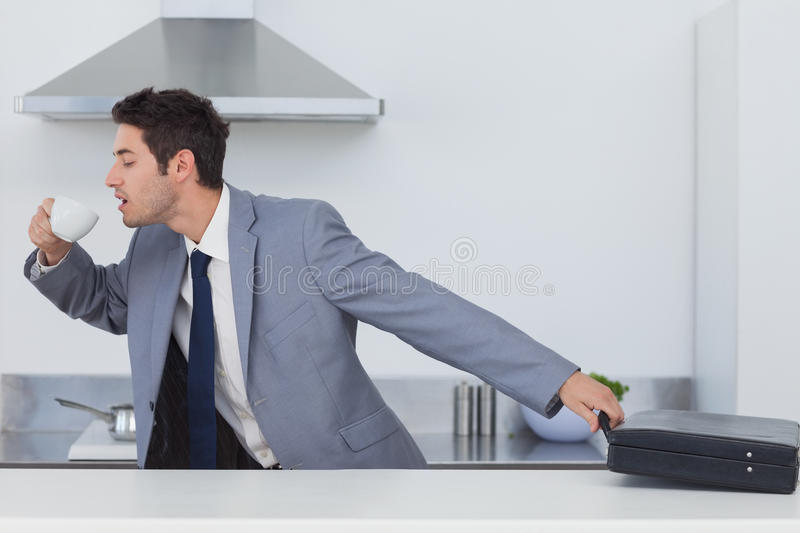 A late businessman taking his briefcase royalty free stock images