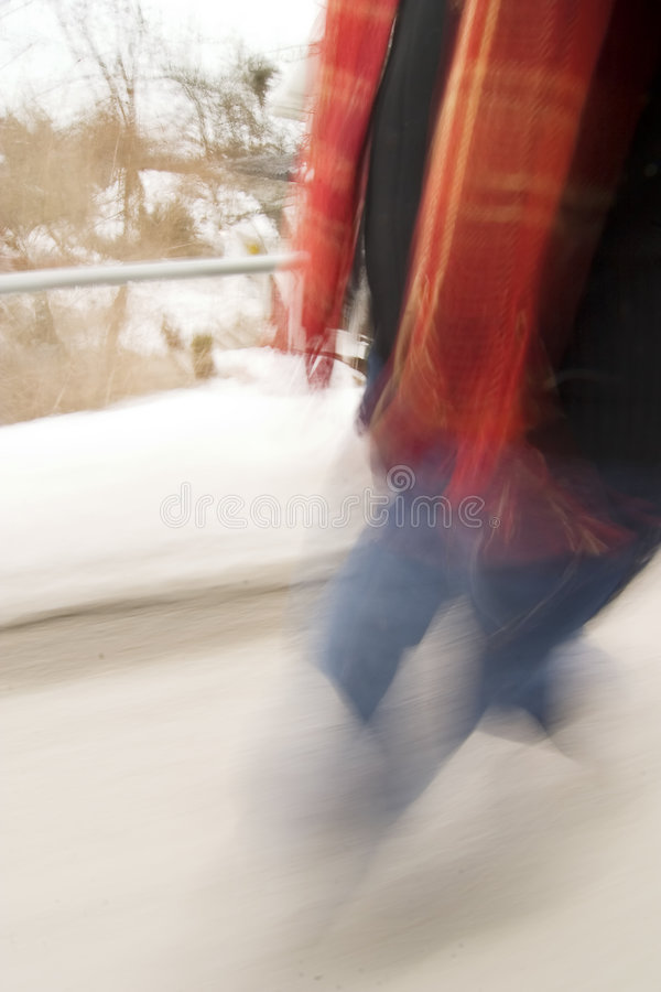 Late Concept. A motion blur abstract of a person walking in a hurry, a late rushing concept image royalty free stock photography