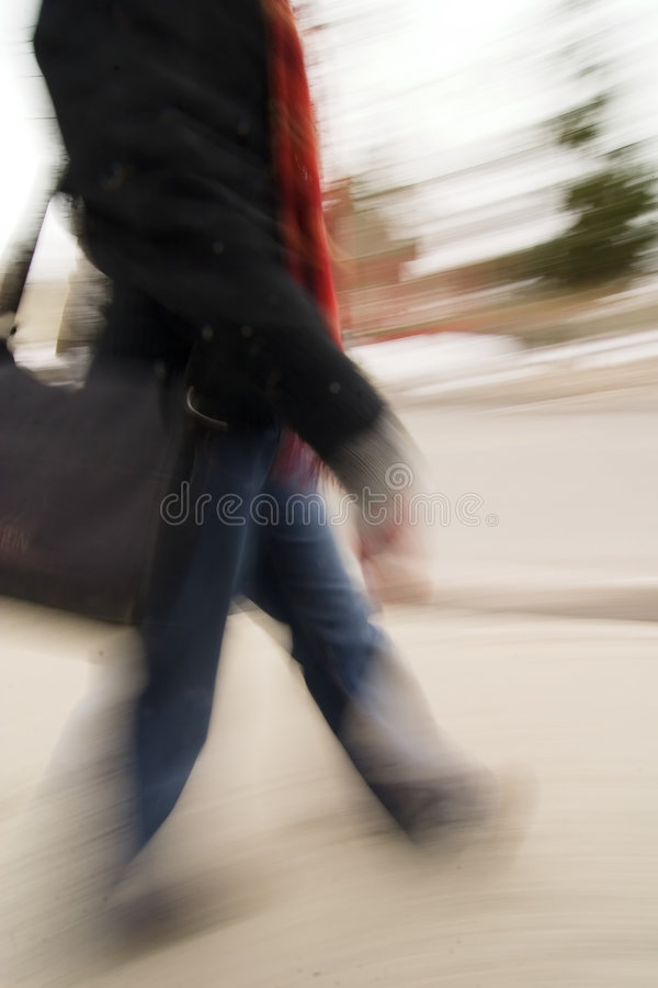 Late Concept. A motion blur abstract of a person walking in a hurry, a late rushing concept image stock photo