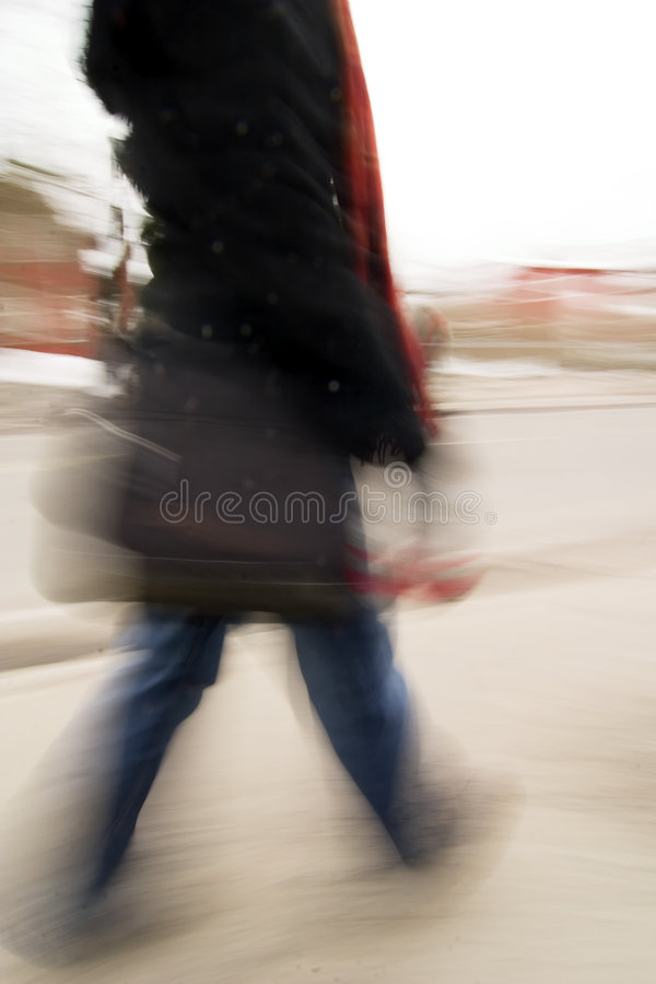 Late Concept. A motion blur abstract of a person walking in a hurry, a late rushing concept image stock images