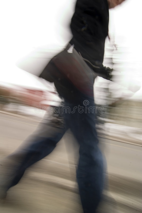 Late Concept. A motion blur abstract of a person walking in a hurry, a late rushing concept image royalty free stock photo
