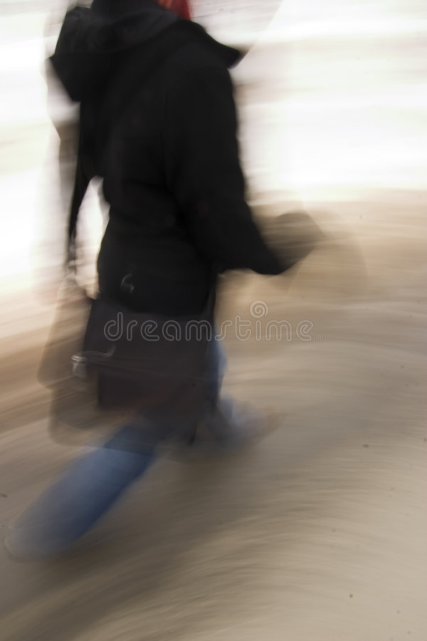 Late Concept. A motion blur abstract of a person walking in a hurry, a late rushing concept image royalty free stock photos