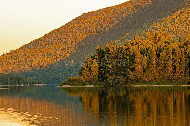 Late Day Light On Big Nictau Lake At Mount Carleton. Looking across Big Nictau Lake at Mount Sagamook in Mount Carleton Provincial Park. The location is in the stock photography