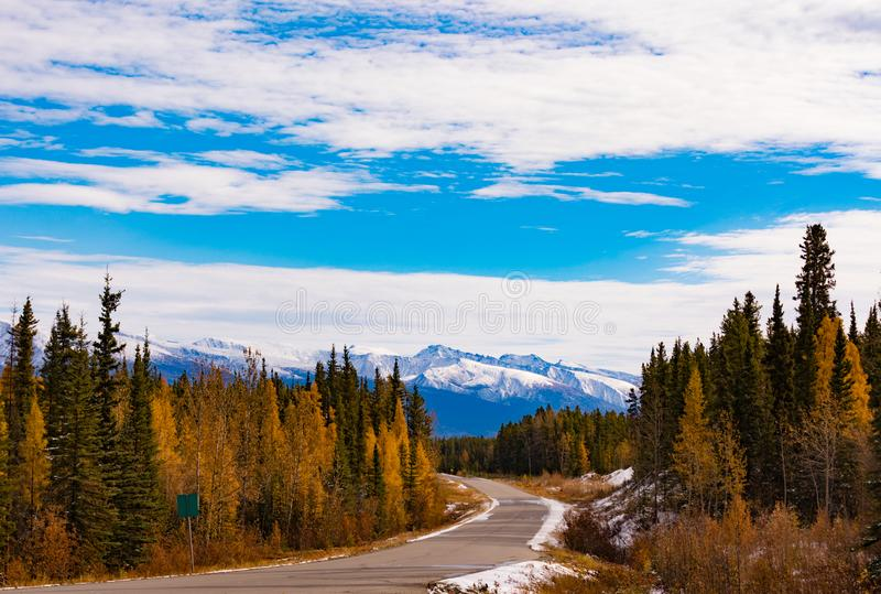 Late fall on Stewart-Cassiar Highway 37 BC Canada. First snow in late fall or early winter at northern section of scenic route of Stewart-Cassair-Highway 37 in stock photos