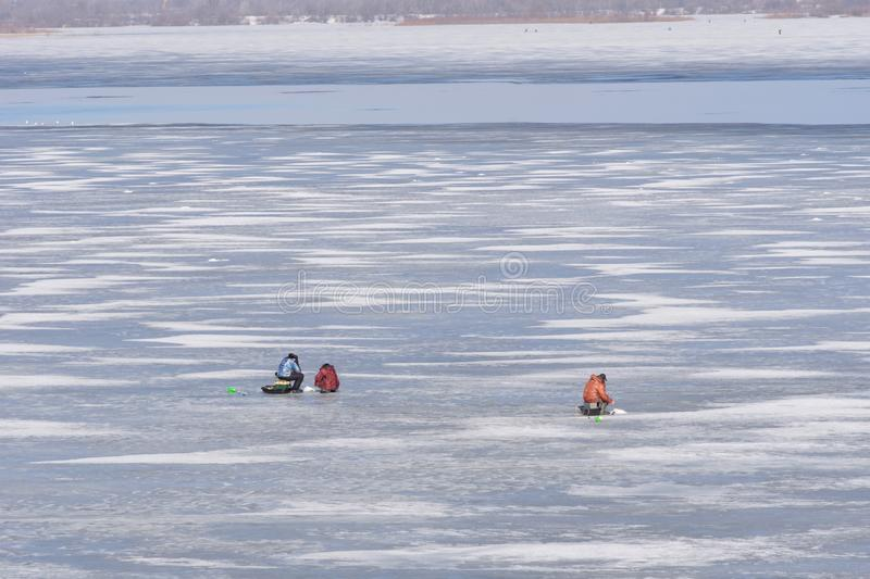Late fishing on the Oka ice. Ice melts and there is open water on it. Fearless stupid fishermen enjoy fishing at weak spring ice stock photography