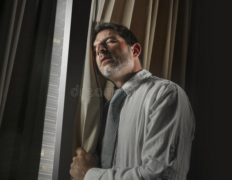 Late night office portrait of young stressed and overwhelmed businessman working under pressure feeling depressed and worried. Suffering anxiety crisis leaning royalty free stock photos