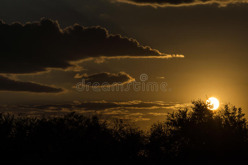 Late orange bright sunset in the countryside.  stock photo