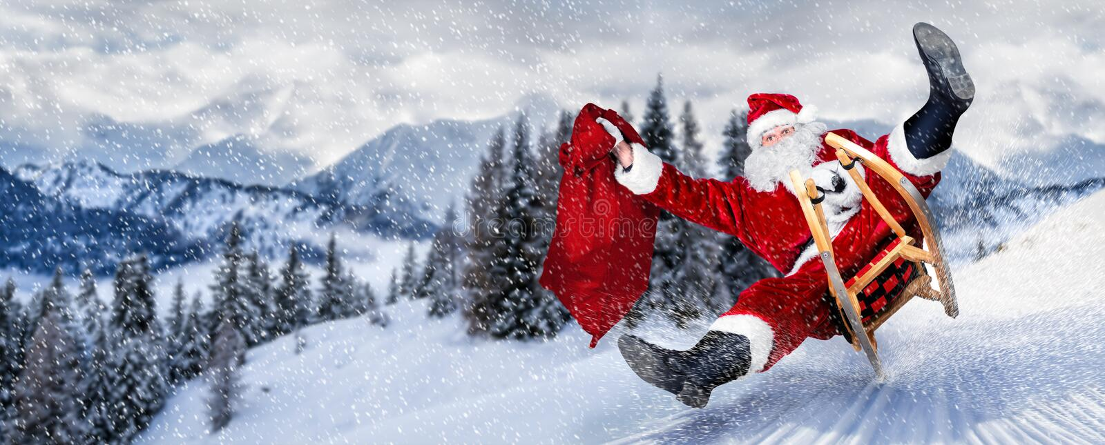 Late Santa claus in a hurry on sleigh sled with traditional red white costume and big gift bag in front of white snow winter. Landscape panorama stock images