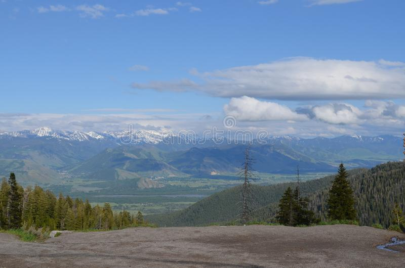 Late Spring in Wyoming: Looking out from Teton Pass to Jackson Hole, Jackson, Snake River, Gros Ventre Mtns and Wind River Mtns royalty free stock photo