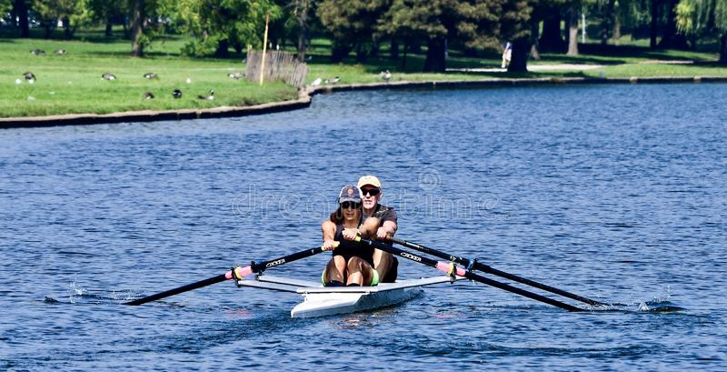 Co-ed Tandem Rower On Lincoln Park Lagoon #3 royalty free stock images