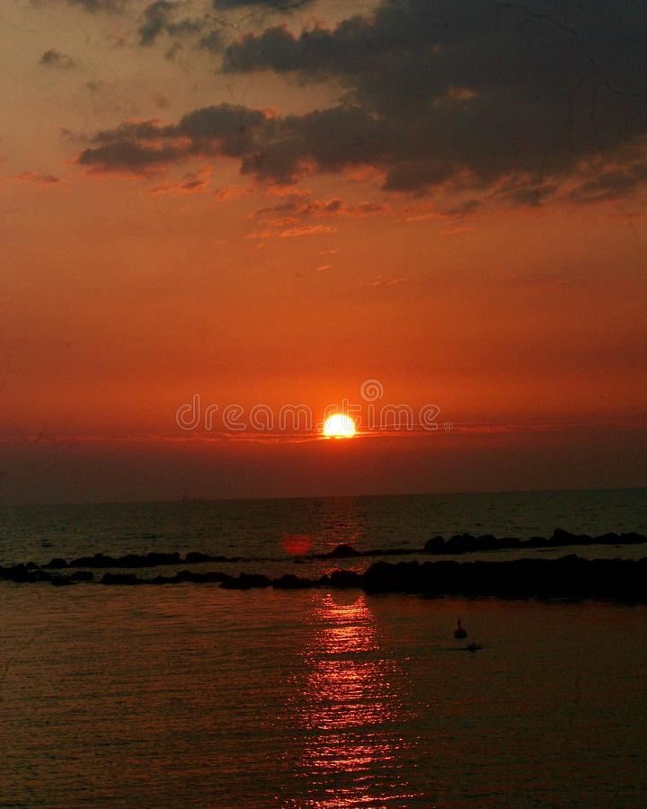 A late sunset at the beach. This photo of the sunset was Made in Marina di Massa in Italy stock photo