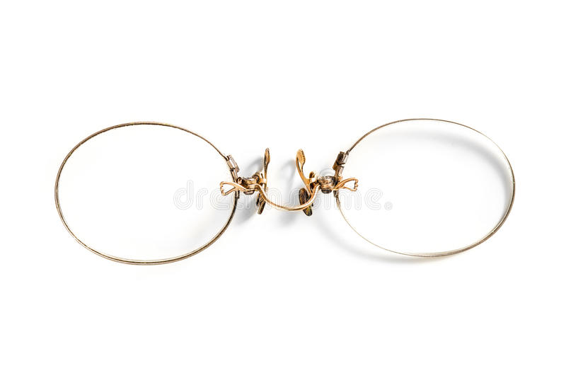 Late 19th century antique pince nez eyeglasses, isolated on whit stock photography