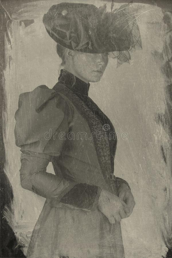 Late Victorian woman in green silk ensemble. A late Victorian 1890`s woman wearing a green silk jacket, hat and skirt with a brown velvet blouse against a white royalty free stock photo